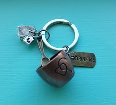 Check out this item in my Etsy shop https://www.etsy.com/uk/listing/470117312/put-the-kettle-on-keyring