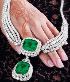 An emerald and diamond necklace, by Cartier. This piece features two large emeralds and carats) surrounded by 75 carats of diamonds.Via Diamonds in the Library. jewelry Cartier emerald and diamond necklace. Emerald Necklace, Emerald Gemstone, Emerald Jewelry, Diamond Jewelry, Diamond Necklaces, Emerald Rings, Emerald Diamond, Blue Sapphire, Sapphire Band