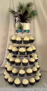 if you want more color, why not wrap the cupcakes in turquoise or purple with coordinating ribbons or alittle bling??