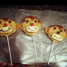 "Monkey pops from the cookbook: ""kids in the kitchen"" (I learned that the lollipop sticks weren't strong enough to hold the rice crispy and it kind o fell apart...I think next time I'll use more marshmallows to make it stay together better) make regular rice crispy treat use drinking glass or cookie cutter to cut circles fr head, chocolate icing to stick on eyes/ears , nilla wafers for ears, chockate m  for eyes, red m or jelly bean for nose and Milano cookie and gel icing for mouth"
