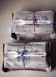 Wrapping bread in a printed or craft stamped brown bag. Love the utensil embellishment.