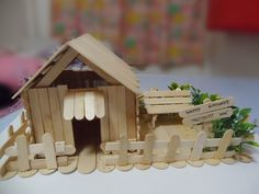 I made a Popsicle house with ice cream sticks! There's garden as well