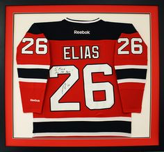 custom framed hockey jersey signed by patrik elias of the new jersey devils designed and