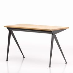 Compas Direction is an incredible desk! Made by famous designer Jean Prouve and manufactured by Vitra, it's a solid oak desk looking spactacular!