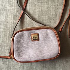 Sawyer Oyster Dooney & Bourke Crossbody Bag Adorable small crossbody bag. Textured leather. Zips open on both sides. Color is kind of between taupe and gray (more taupe if you ask me). Dooney & Bourke Bags Crossbody Bags