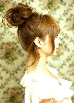 Keep it loose and loopy. | 19 Ways To Take Your Top Knot Game To The Next Level
