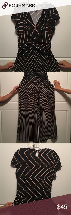 Black/Taupe Jumpsuit Sizzle your way through the season in this gorgeous full-length jumpsuit.  Black & Taupe plus oversized golden zipper.  96% polyester, 4% spandex.  NWT JBS Pants Jumpsuits & Rompers