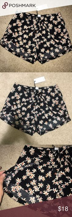 Black floral shorts! Ties in front! Size: Small, Brand: Love Ritchie. Purchased in a cute boutique in San Diego. Too small for me but they don't do returns after a week so I cannot return/exchange for a larger size. Tags:brandy melville, Nasty Gal, ASOS, Urban Outfitters, One Teaspoon, For Love and Lemons, Forever 21, Zara, Top Shop Free People Shorts