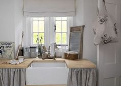 Like the grey and white scheme, and love the deep farmhouse sink.  Fun accessories...
