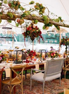 Tented Wedding Reception -- Love the sweetheart bench and the low-hanging floral fixture!! See lots more on SMP: http://www.StyleMePretty.com/mid-atlantic-weddings/2014/03/18/outdoor-blue-ridge-mountains-fall-wedding/ Jen Fariello Photography | Southern Blooms By Pat's Floral Designs