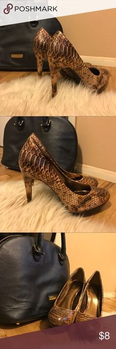 Snakeskin platforms leather heels stilettos pumps adorable vegan leather vegan snakeskin pumps. So cute!!!! Wear these all summer long !! Platform height is half-inch. Heel height is 5 inches. This makes rise of shoe four and a half inches. Size 9. So adorable. In amazing shape. Few flaws see picture. Reason for a lower price. Can't even see the flaws unless they are pointed out!! Bundle and save!! Xo Bakers Shoes