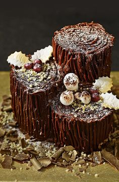 A magical twist on the traditional yule log, try our Collection Tree Trunk Chocolate Yule Log. It is a chocolate sponge, filled with buttercream, covered in milk chocolate ganache and decorated with soft icing decorations. Christmas Cake Decorations, Christmas Sweets, Christmas Cooking, Noel Christmas, Christmas Goodies, Icing Decorations, Christmas Chocolate, Christmas Cakes, Christmas Cake Designs
