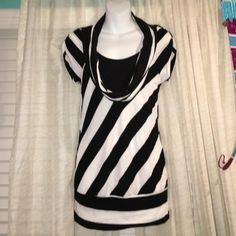 2b Bebe striped top Thin sweater like material. Scowl neck with sown in black chest covering. Goes past my but when wearing and I am 5'3. Stripes on front are diagonal, back are horizontal. bebe Tops Tunics