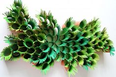 green-ferns-paper-sculpture - Super basic idea, turned into an awesome wall sculpture! Just cut up painted paper towel and toilet paper rolls and create a picture using the texture. Just save rolls over time, and it's virtual free! Picture found at http://www.recyclart.org/2012/08/nature-inspired-wall-sculpture-from-paper-towel-rolls/#