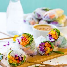 These Fresh Spring Rolls are a colorful, crunchy vegan meal perfect for a light lunch. They are served with an amazing Peanut Ginger Sauce.