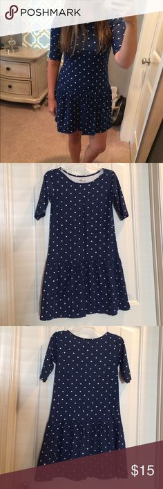 """Navy Polka Dot Drop Waist Dress Cute drop waist dress that is in great condition. It is technically a kid's size large (10-12) but would fit XS to small so I've listed it as XS. It would be a cute game day dress with boots in the fall. If not wearing with leggings I wouldn't recommend it for someone taller than 5'4"""". 100% cotton Old Navy Dresses"""