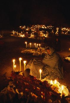 Mexico | Candles light a cemetery during Day of the Dead ceremony