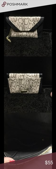 NWOT Steve Madden clutch Beautiful leather clutch. I purchased and never used. Very roomy. Steve Madden Bags Clutches & Wristlets