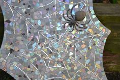 spider web mosaic.  On her blog she talks through her process of creating this piece.
