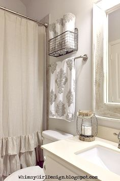 This guest bathroom has limited storage, with only one cabinet under the sink. I needed a functional, yet pretty way to add more space. I came across this wire hanging basket at HomeGoods and knew it would look great! The decorative towels add a pretty pattern to the room and it's nice to have them accessible to our guests.