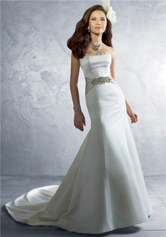 Straplessfit and flare satin gown with a bead encrusted scooped neckline, dazzling beaded satin belt available in 62 colors,  and a semi-cathedral train.