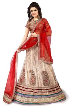 Net Party Wear Lehenga Choli In Cream Colour.It comes with matching Dupatta and Choli.It is crafted with Resham Work,Zari Work,Stone Work,Mirror Work,Patch Work Design This Lehenga Choli can be Stitch...