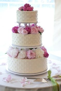 A gorgeous wedding cake. The layers of peonies give it the feel of a gorgeous centerpiece.