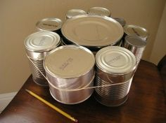 Tin Can Xylophone - oh so fun and oh so easy! Teach the kids about recycling and making beats!