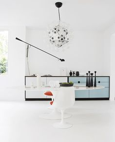 '265' wall lamp and 'TARAXACUM 88' pendant lamp from #FLOS with table and chair by Saarinen