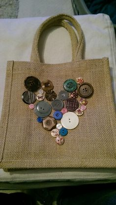 Decorated a Hessian bag with old buttons to make a pretty lunch bag for work. Hessian Bags, Jute Bags, Diy Tote Bag, Patchwork Bags, Denim Bag, Fabric Bags, Button Crafts, Handmade Bags, Bag Making