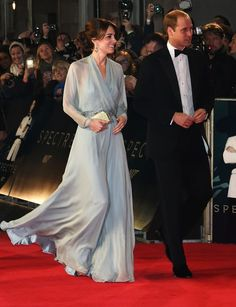 William was wearing a black tuxedo while Kate was resplendent in a blue Jenny Packham evening gown with Jimmy Choo shoes at the James Bond film premiere in London