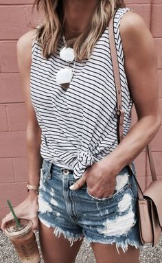 Wearing a knotted top with denim jeans