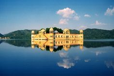 Explore The Pink City Jaipur in Rajasthan, India...Jal Mahal  This is built to be a pleasure palace for the royal family in 1799, Jal Mahal Palace (translated as Water Palace) of Jaipur is an extremely romantic place with its red sandstone intricate architecture casting beautiful reflections in the calm waters of the Man Sagar Lake, full of hyacinths. Surrounded by Nahargarh Hills, Jal Mahal is known for its majestic architecture and sophisticated design.