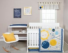 Blue yellow and grey rocket ship galaxy solar system baby nursery decorating ideas with appliqued crib quilt and baby bedding set, nursery window topper and DIY wall décor.