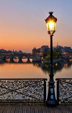 The Pont des Arts bridge in Paris where lovers leave a padlock with their names and throw the key in the Seine