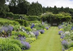 Large herbaceous borders with a mix of perennials replaced Victorian bedding. Credit: Jason Ingram