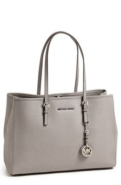Free shipping and returns on MICHAEL Michael Kors 'Jet Set - Large' Saffiano Leather Tote at Nordstrom.com. Polished logo hardware and buckle details provide a refined finish for a spacious tote crafted from lustrous Saffiano leather.