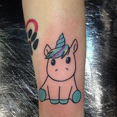 Cartoony 'corns are good, too: | 20 Magical Unicorn Tattoos