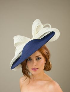 The Portland Dish Hat comprises a dish base trimmed to the back with a large, diamond patterned sinamay bow which wraps around the underside of the brim. Millinery Hats, Fascinator Hats, Fascinators, Fancy Hats, Cool Hats, Kentucky Derby Outfit, Derby Outfits, Derby Attire, Summer Wedding Outfits