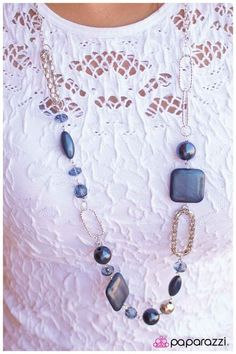 Oops a Navy $5 Deep navy blue beads in an assortment of shapes and sizes combine with loops of silver mesh chain, a metallic silver bead, oval rings with texture and translucent blue gems with faceted edges along a silver chain. Features an adjustable clasp closure. Sold as one individual necklace. Includes one pair of matching earrings.