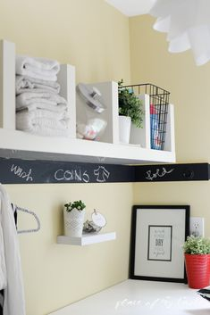 An organized laundry space! Love the chalkboard wall!