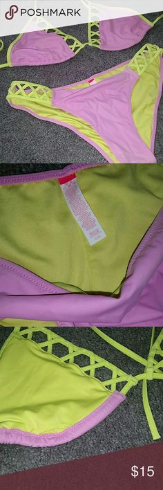 VS PINK BATHING SUIT Neon yellow and lavender, super cute!!! I love the tan lines from the patter on the top and the hips. No padding but has space for inserts. Never worn!!! Make offers!! PINK Victoria's Secret Swim