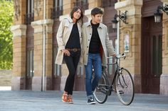 Stylish couple. Casual trench look. Vintage bike. Teatro Arriaga.