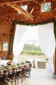 The elegance of a barn wedding. String lighting overhead uses C9 string lights with G50 clear bulbs. Both available online at http://www.partylights.com/Strings-Bulbs/C9-Strings-Bulbs.