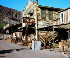 Calico, CA This former silver-mining town in Southern California peaked in the 1880s, but started declining when the price of silver dropped in the 1890s. It was a ghost town by 1907. The town's restoration began in the 1950s, under the direction of Walter Knott, of Knott's Berry Farm fame. Today, Calico is a San Bernardino County Park, but you can still see one-third of Calico's original buildings.