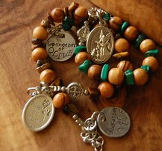 One Decade Prayer 10mm Olive Wood, and Tiger Eye and Malachite beads. Personalized. Hand Stamped. Guardian AngelCatholic One Decade bracelet ( Prayer Beads) Beautiful peace and perfect gift for any occasion.  Tiger Eye lets you see everything. Use it for insight and you can be a very lucky person. When used in jewelry the tiger eye may bring good luck and protection from the evil eye to the wearer. It also known to bring clear thinking and insight    - Tiger Eye is a powerful stone of good…