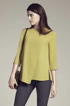 The Bourgeois Blouse Meet the T-shirt's sophisticated French cousin. With an airy layer that wraps across the body, subtle darts at the bust, and a delicate closure at the nape … Formal Tops For Women, Womens Trendy Tops, Blouse Styles, Blouse Designs, Hijab Fashion, Fashion Outfits, Formal Blouses, Sewing Blouses, Moda Chic