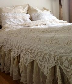 Fabulous bed dressing with vintage linens