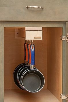 Hangs cookware and keeps it out of sight— Glideware is the only product of its kind and the last organizer you will ever need.