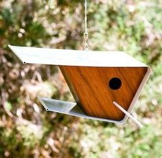 Ultra sleek birdhouse is ingeniously handcrafted of formed wood with a steel surround. A perfect addition to any contemporary landscape, the mid-century design is quality constructed and built to last